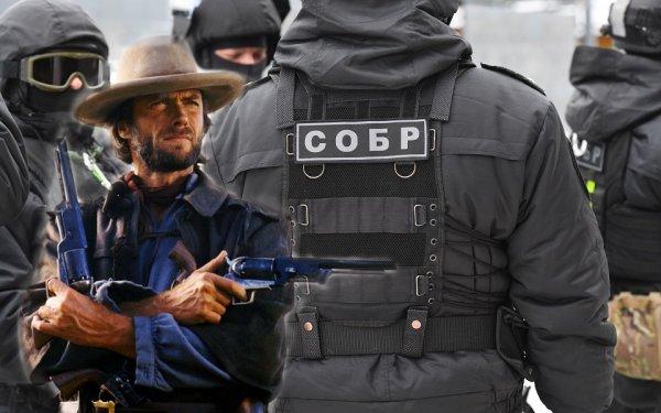 Он что ковбой? Необычное фото бойца СОБРа с двумя «пистолетами» удивило россиян